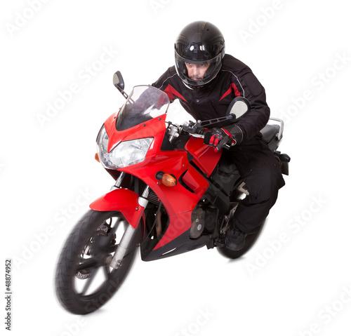 Man riding a motorbike - 48874952