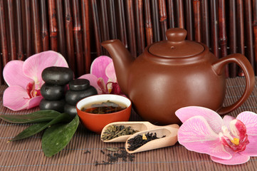 Chinese tea ceremony on bamboo table on bamboo background
