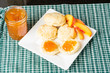 Fresh biscuits with peach jam