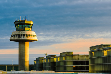 Airport control tower at sunset in Barcelona, Spain
