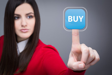 Businesswoman clicking buy button