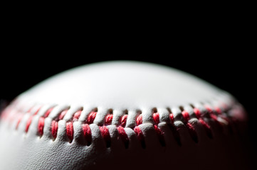 Baseball over black background, horizontal shot