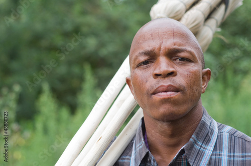 Worried South African entrepreneur small business broom salesman