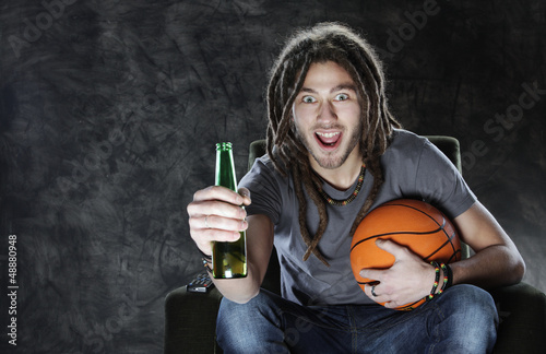 Basketballl fan watching television