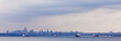 Oil tankers anchor Vancouver skyline BC Canada