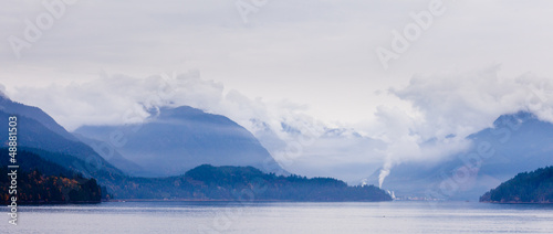 Rain clouds on coastal mountain ranges BC Canada