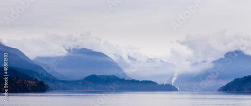 Rain clouds on coastal mountain ranges BC Canada