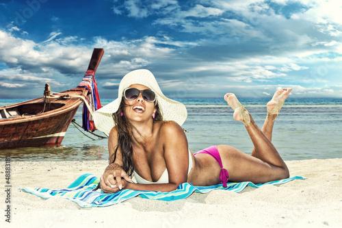 Beautiful woman on the beach. - 48883181