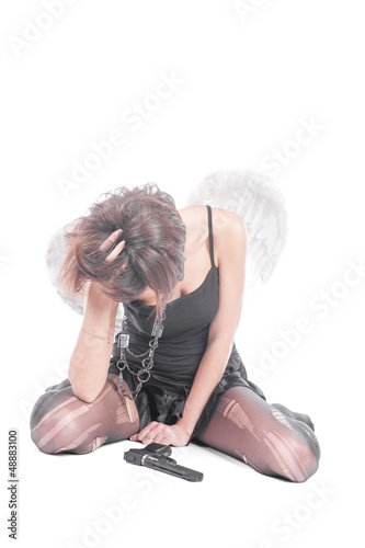 female brunette angel with gun