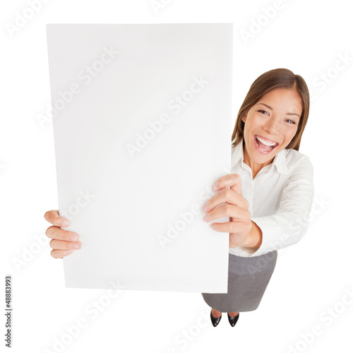 Businesswoman with blank sign excited