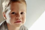 on a light background portrait of smiling boy