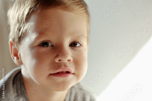 on a light background portrait of smiling boy