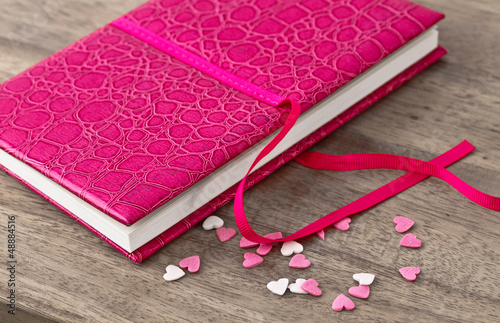 leather case notebook on wooden background