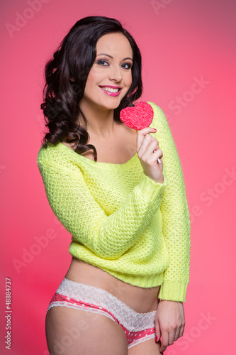 Sexy smiling woman with lollipop