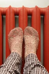 feet with wool socks warming on the radiator