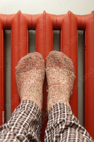 feet with wool socks warming on the radiator