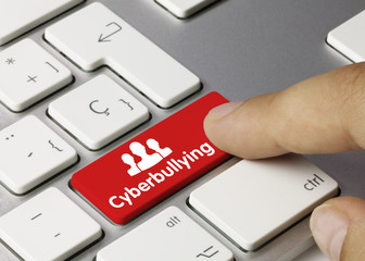 Cyberbullying keyboard key. Finger