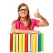 Student girl with pile book showing thumb up