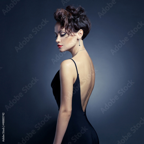 Elegant lady in evening dress - 48885742