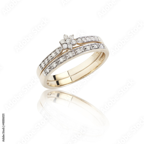 Diamonds ring on golden body shape the luxurious accessories