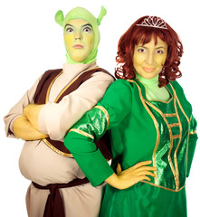 Actor and actress wearing as Shrek and Fiona