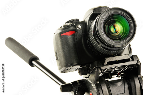 Single-lens reflex camera on tripod isolated on white