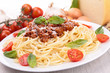 spaghetti with bolognese sauce and basil