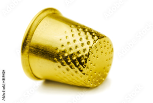Golden sewing thimble