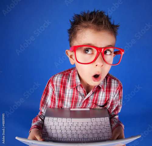 Little boy with a laptop, computer addiction concept