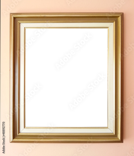 Empty golden frame on wall