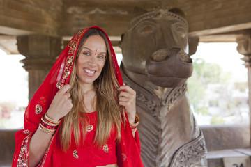Woman in red sari at Khajuraho Temple.