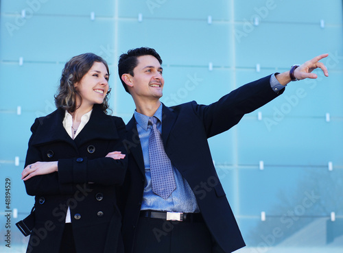 A couple of young Caucasian business persons in formal clothes