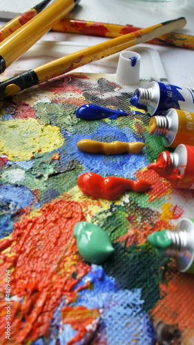 Tubes with paints and paintbrushes