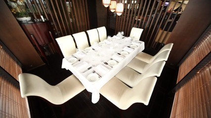 Table for ten persons stands in separate room