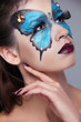 Fashion Make up. Butterfly makeup on face beautiful woman. Art P