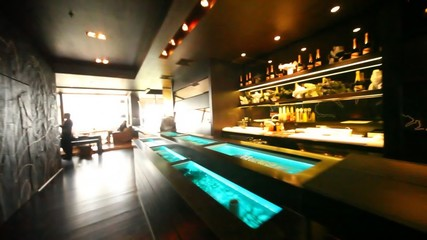 Aquariums with oysters are built in bar counter