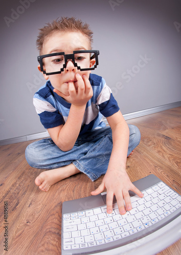 Little boy with laptop computer