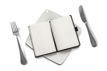 gnawing science. notebook on a plate & white background.