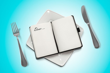 notebook on a plate and blue background.