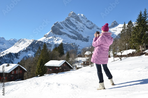 Girl taking a photo in Swiss Alps
