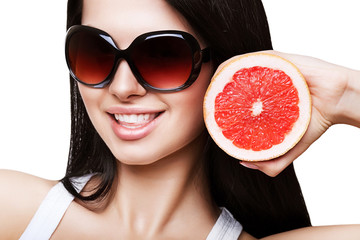 sexy smiling woman with grapefruit in sundlasses