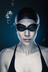 close-up portrait of swimmer in black with bubbles