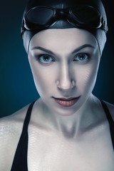 close-up vertical portrait of swimmer with fish scale