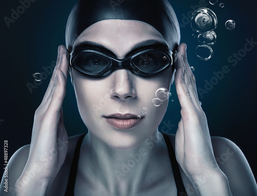 close-up portrait of swimmer with bubbles