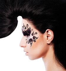 woman with creative hair and face art with rhinestone