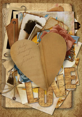 Vintage background with paper heart and old postcards and photos