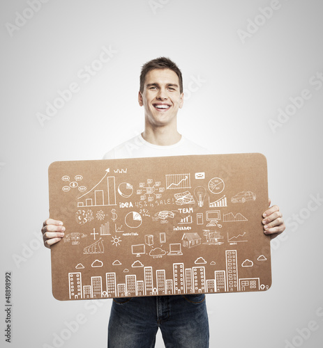 man holding poster with business concept