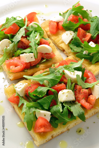 Focaccia with tomatoes, rocket and mozzarella