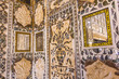 details of walls in rich decorated Amber fort in Jaipur, India