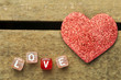Word love on multicolored wooden cubes on wooden background